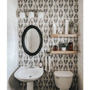 wallpapered small bathroom