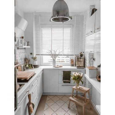 white blinds small kitchen